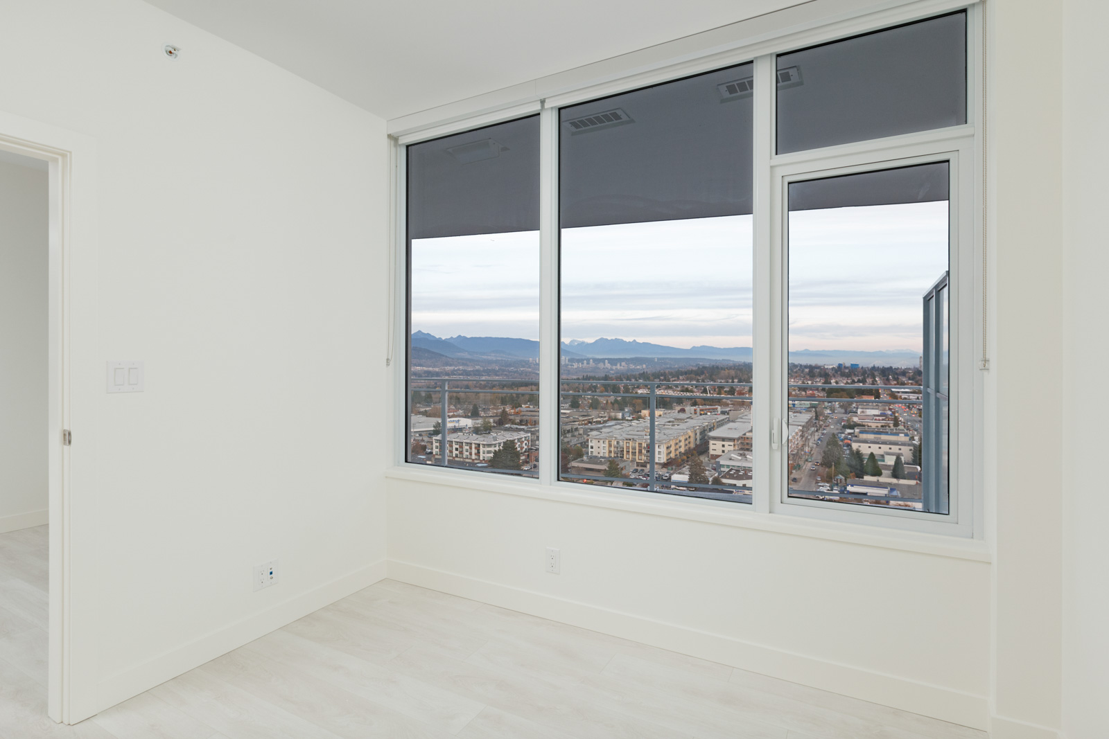 windows from bedroom with white walls of burnaby metrotown condo