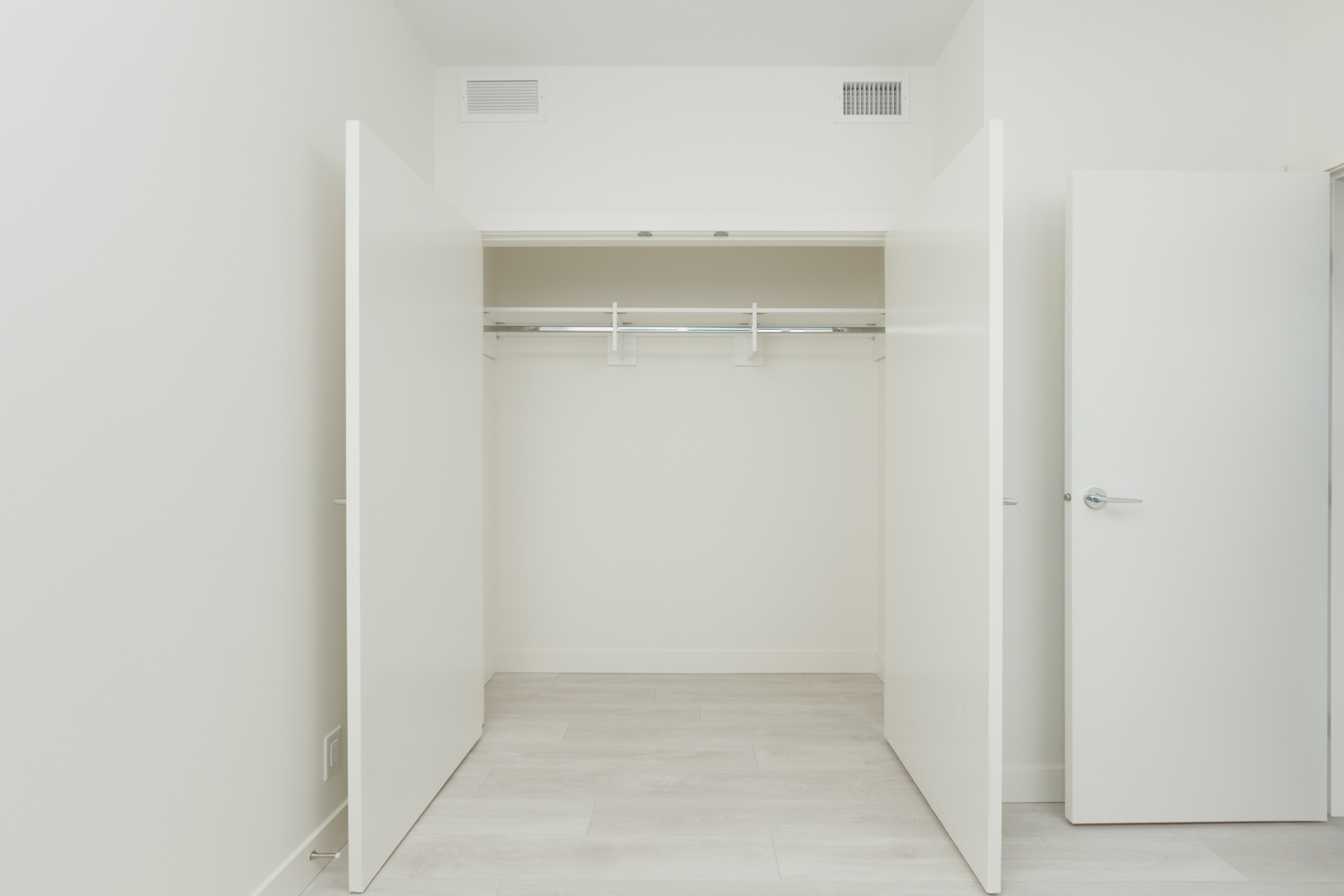 closet with two open doors in bedroom of burnaby condo