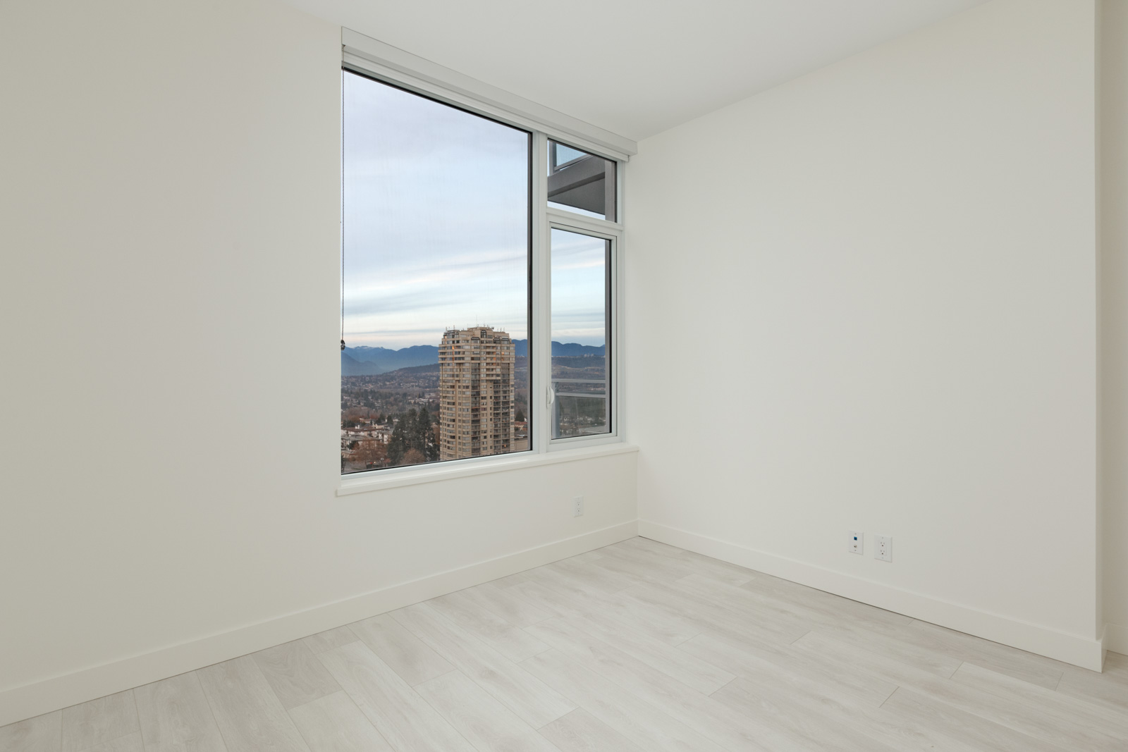 room with white wall and window in condo apartment