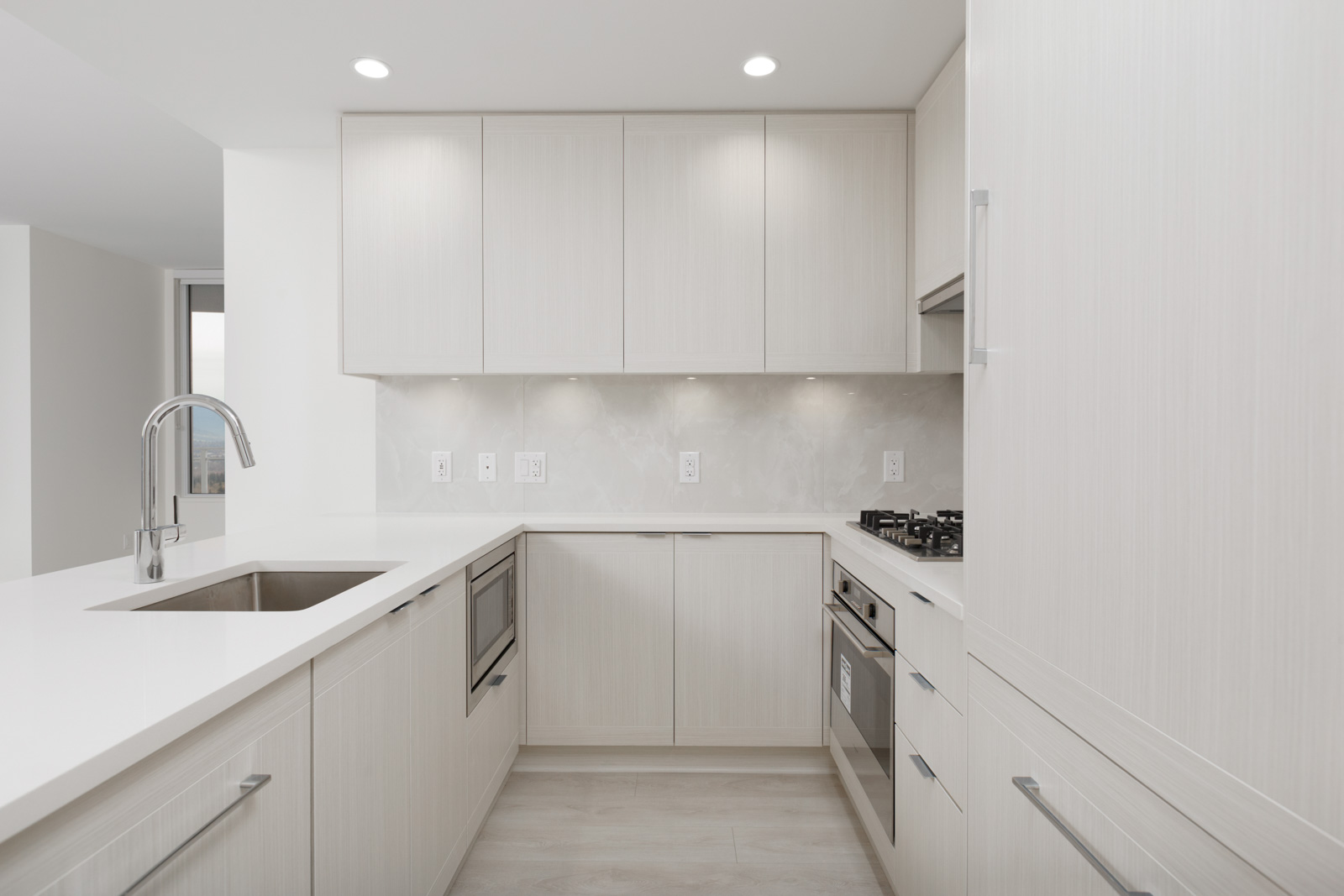 kitchen with white cabinets and countertops in burnaby condo