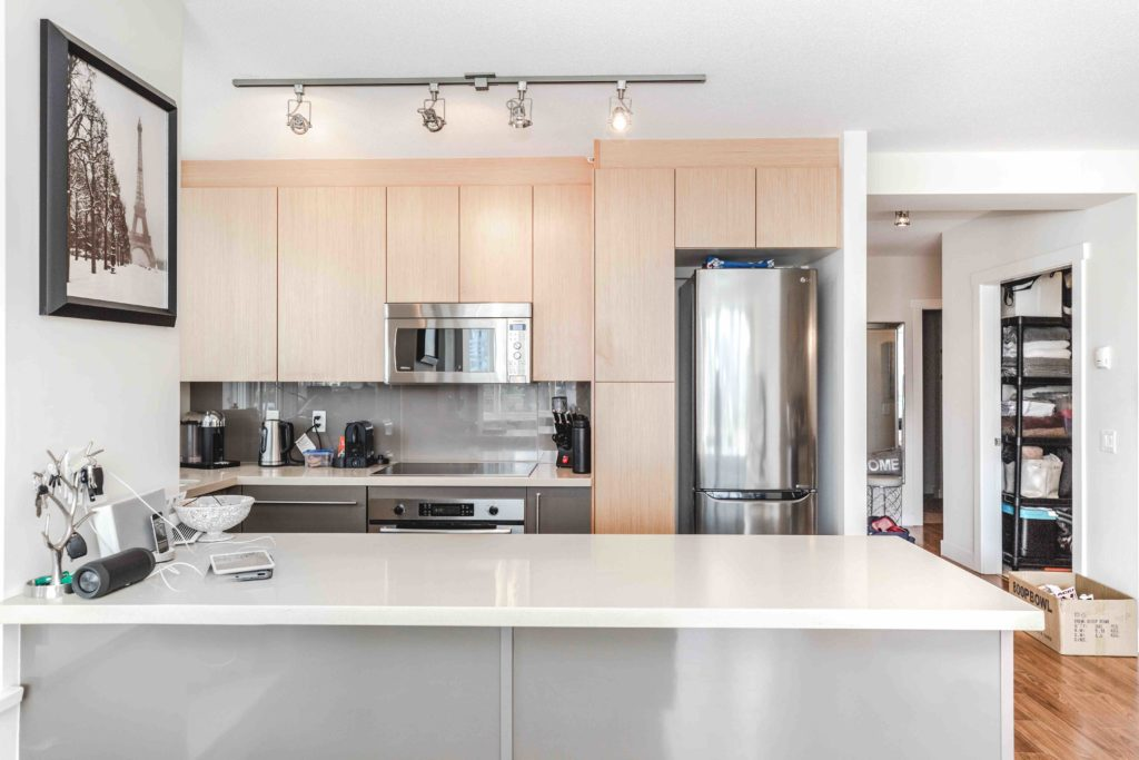 kitchen in olympic village rental condo with track lighting