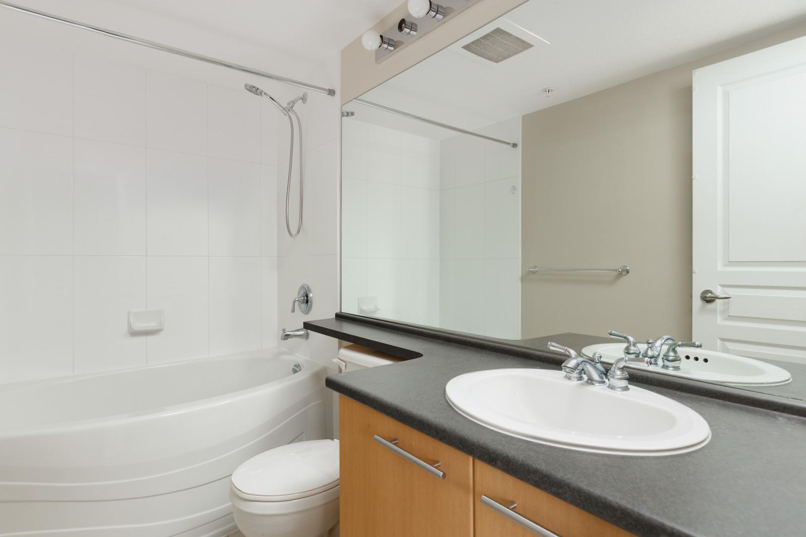 bathroom with wash basin mirror and bathtub