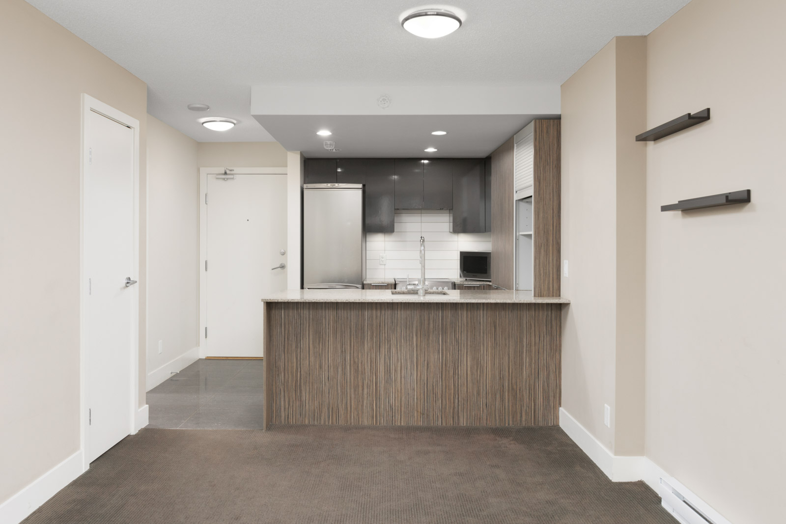 condo kitchen in yaletown vancouver with counter and hardwood floors