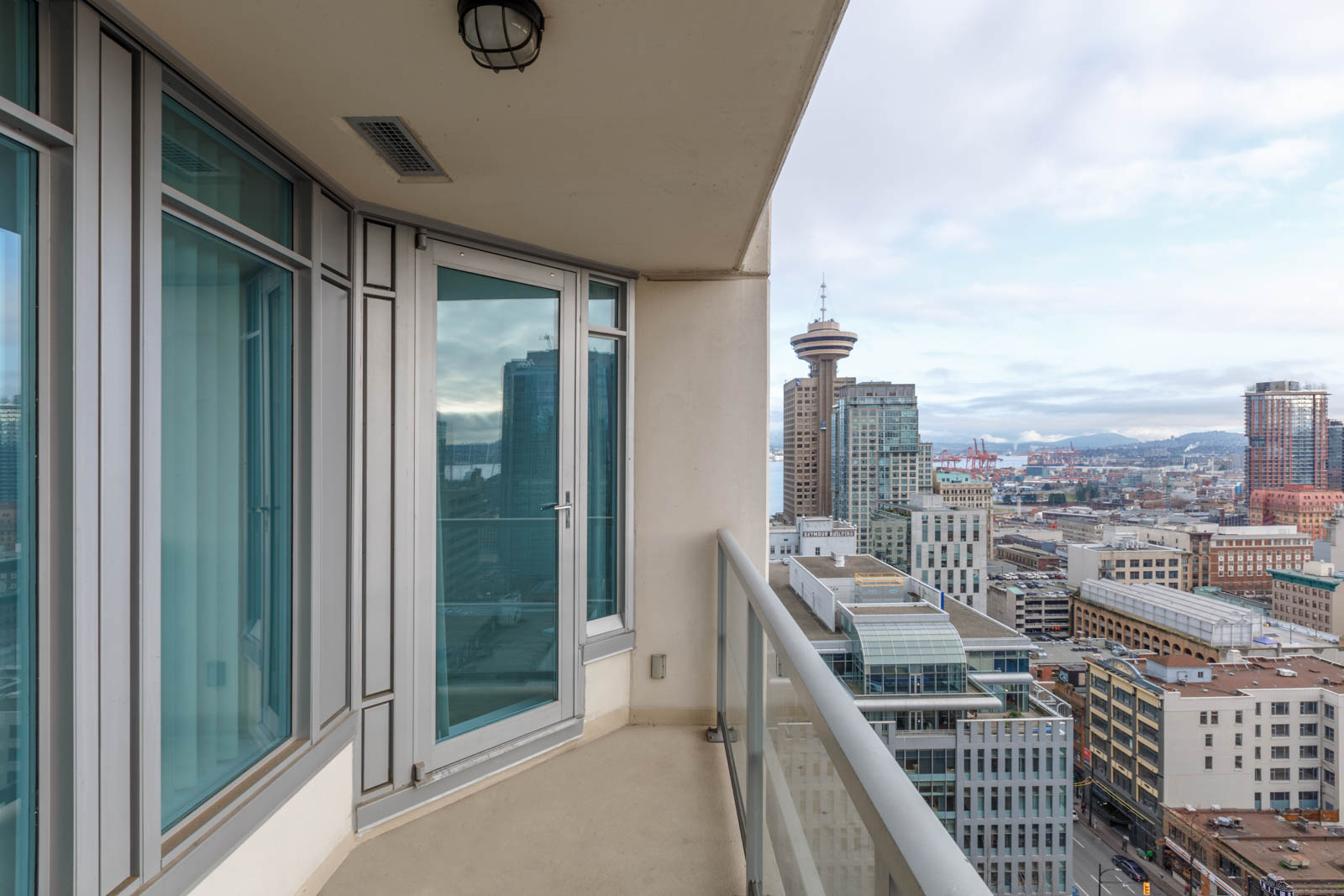 A large balcony on the 20th floor with views of Harbour Centre