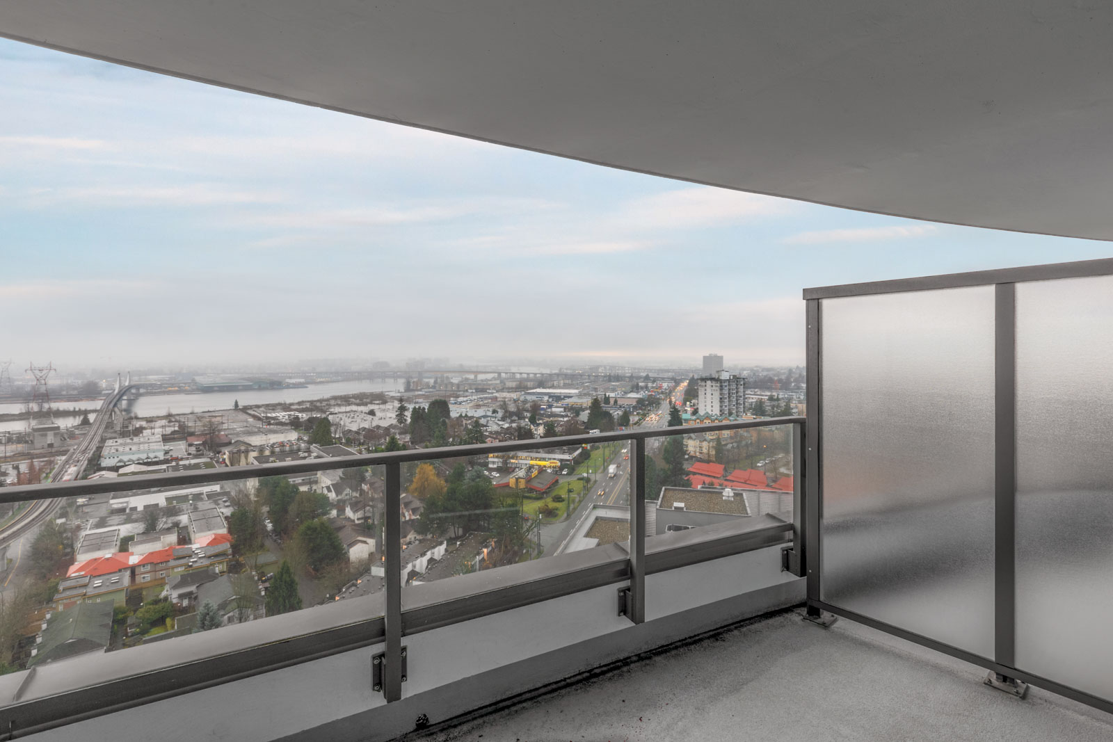 view of city and sky from balcony of rental condo in cambie and marine hub of vancouver managed by birds nest properties