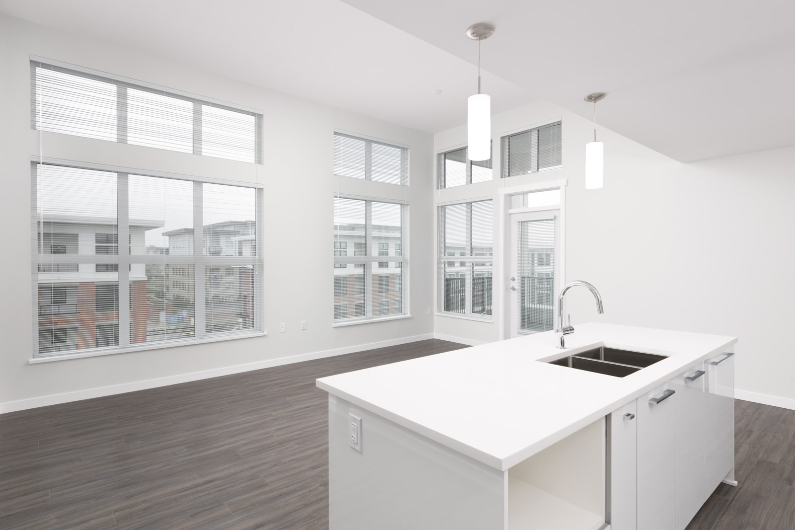 white kitchen counter in living room of rental townhouse in richmond with windows
