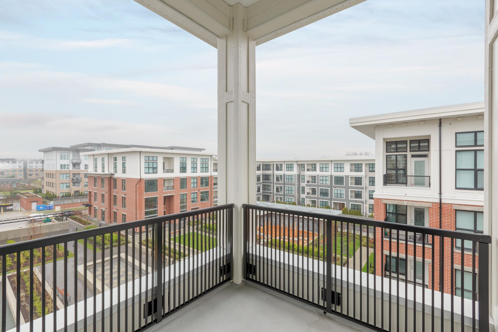 corner balcony patio of richmond rental townhouse unit overlooking multi family apartment building