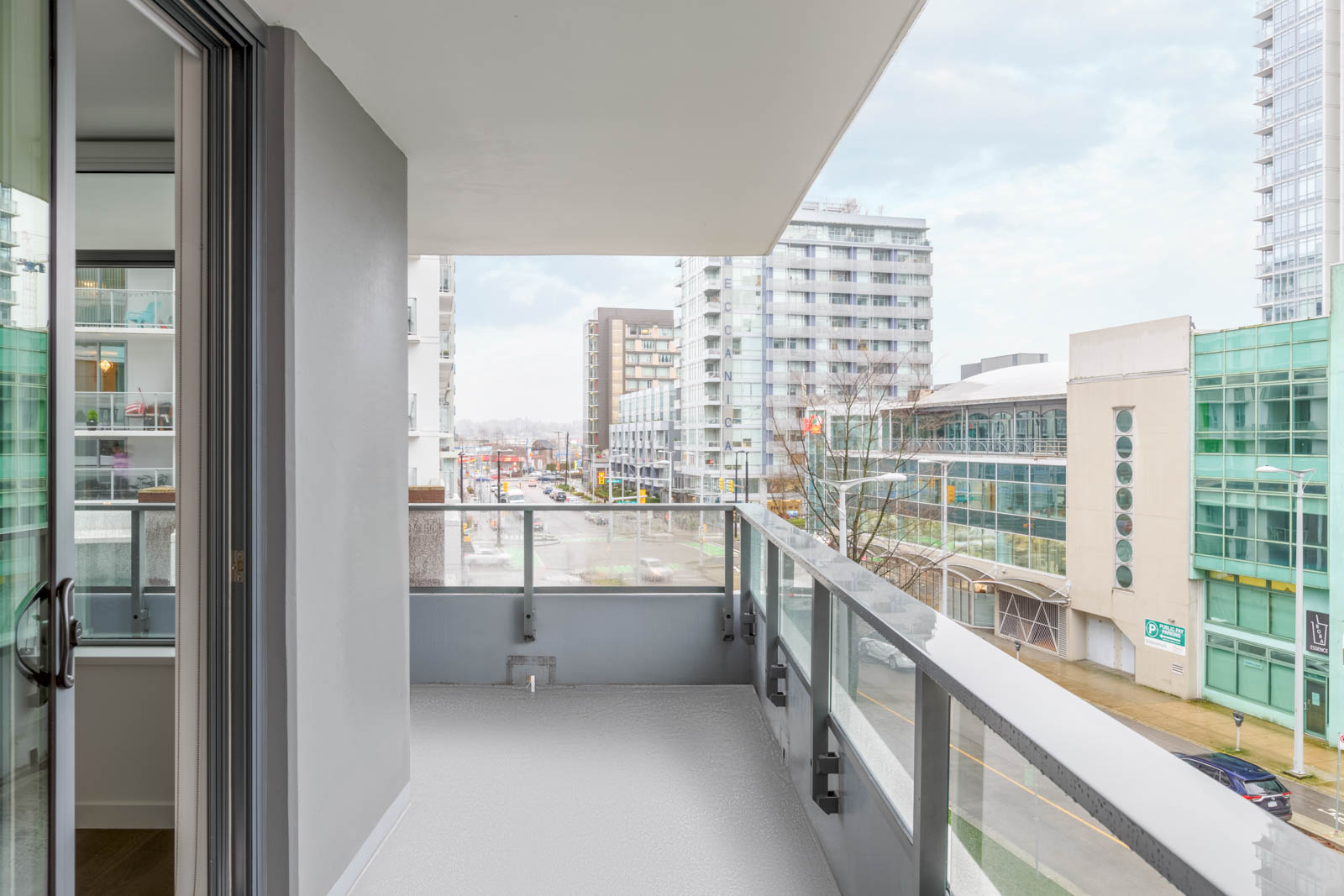 wraparound balcony overlooking olympic village vancouver from leed gold navio south condo building