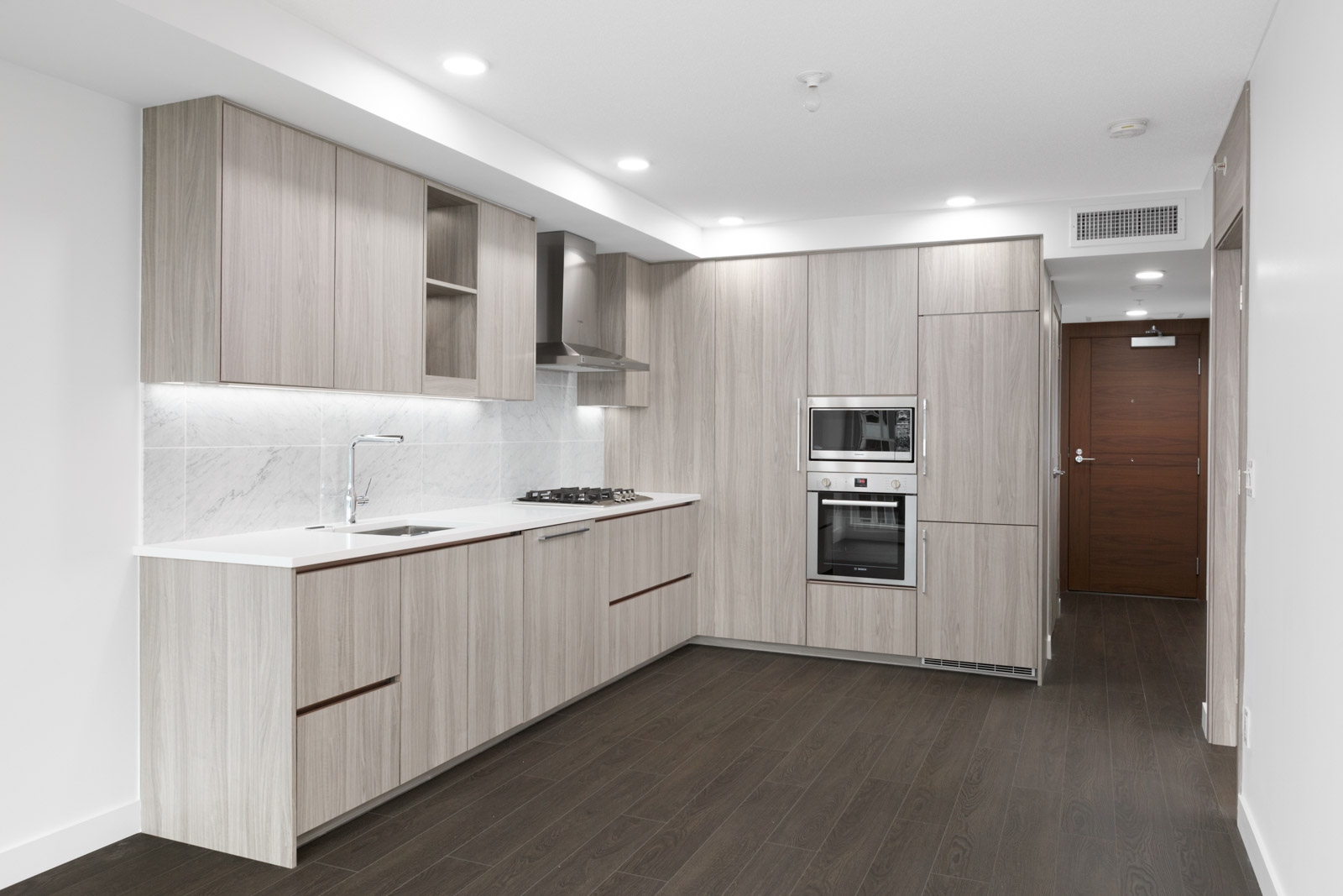 modern kitchen of new empty living room in concord gardens south estate on hazelbridge in richmond