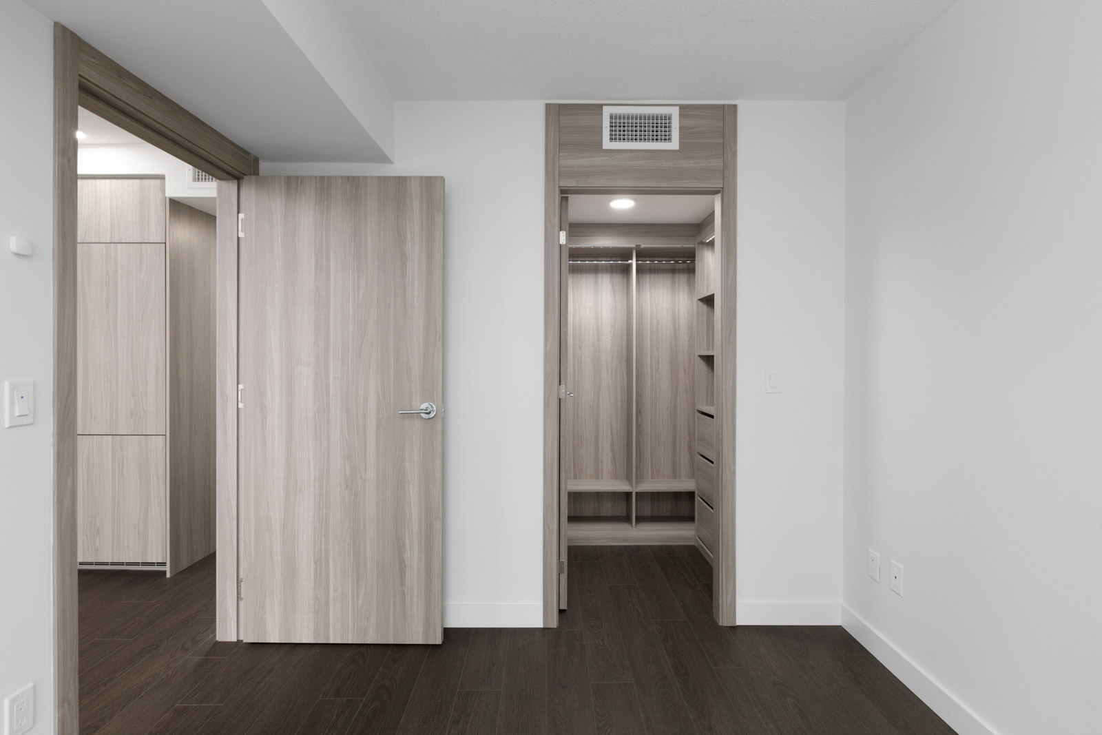open door on left and view of walk in closet of bedroom in new empty condo in concord gardens south estate on hazelbridge in richmond