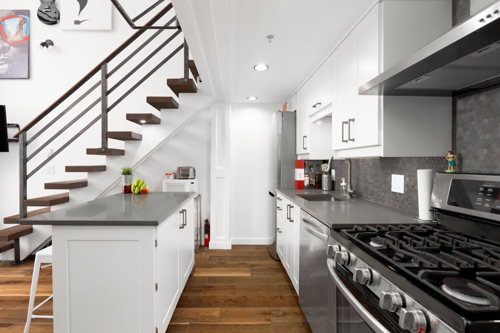 Kitchen under stairwell at 933 Seymour Street