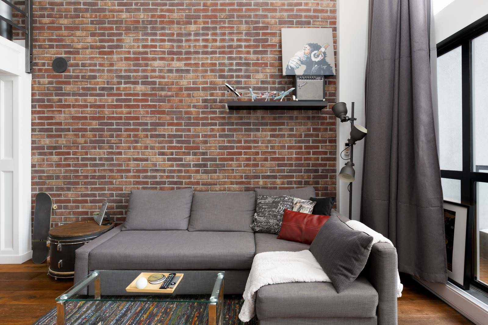 Living room in 933 Seymour Street Loft with Brick Wall Feature