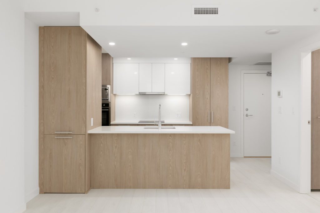 kitchen of empty new rental condo at the independent in mount pleasant vancouver managed by birds nest properties