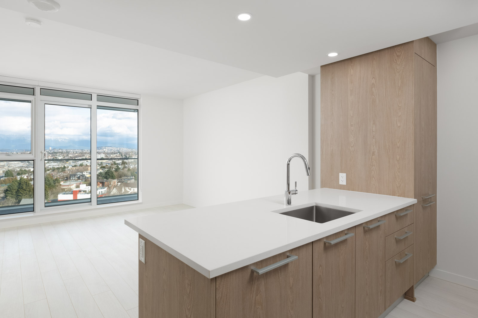 kitchen island with sink of empty new rental condo at the independent in mount pleasant vancouver managed by birds nest properties