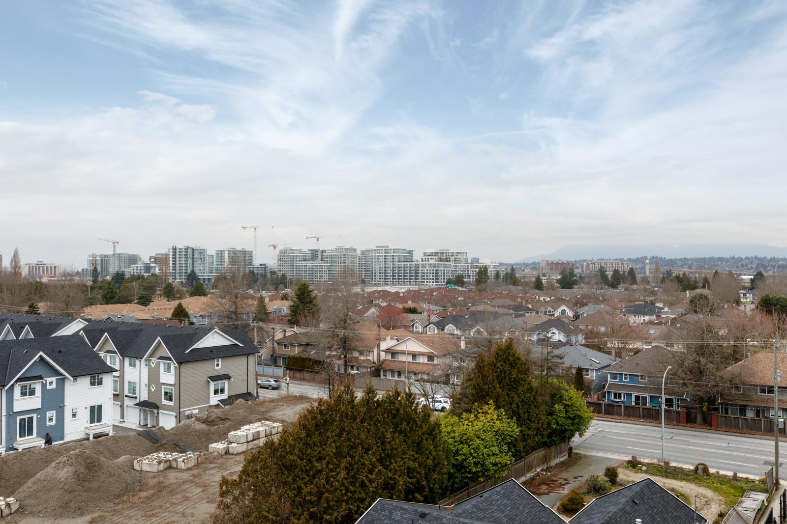view of bright sky and city from rental condo in richmond at remy on stolberg managed by birds nest properties
