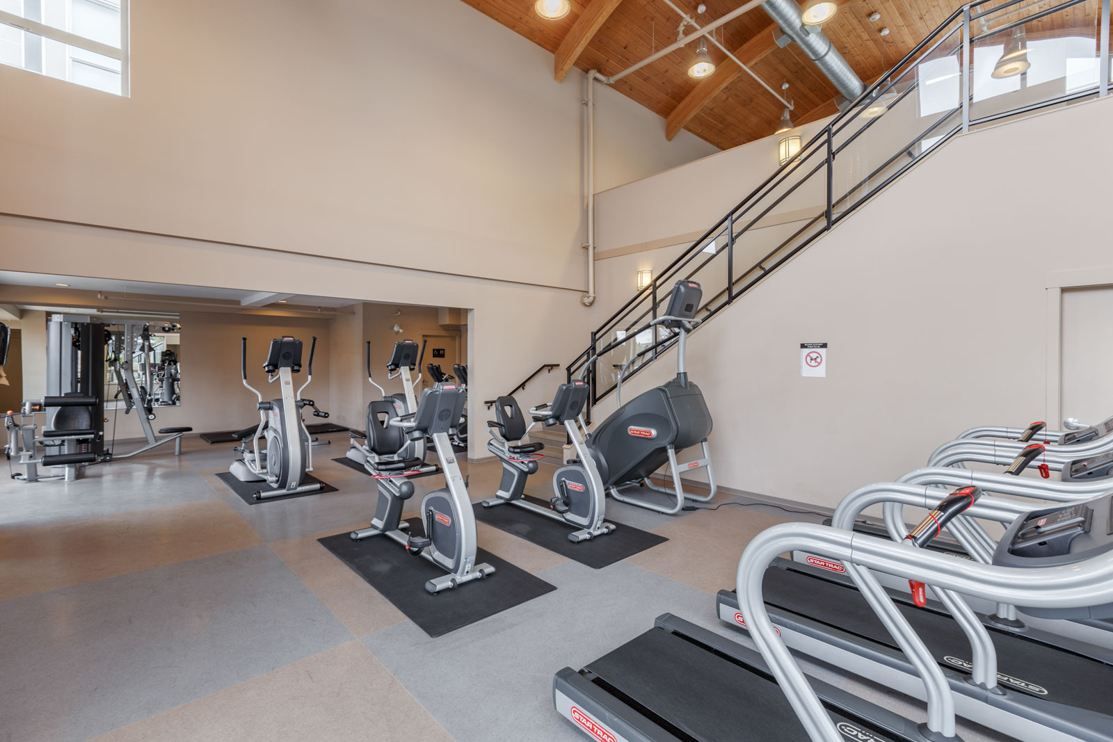 treadmills in gym facilities of remy condo building in richmond with rental properties managed by birds nest properties