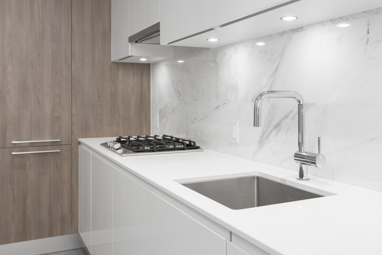 kitchen counter and sink and stovetop in brand new condo at brentwood tower one of amazing brentwood in burnaby