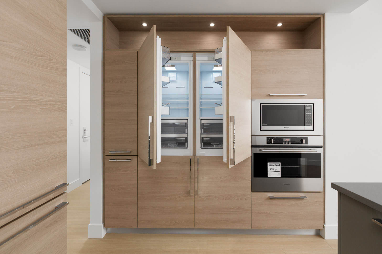 open refrigerator doors in empty brand new condo managed by birds nest properties at kings crossing in burnaby