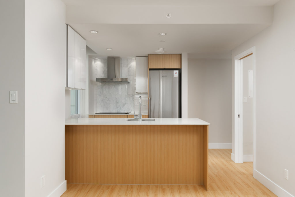 kitchen of rental condo at tower green in false creek olympic village vancouver managed by birds nest properties