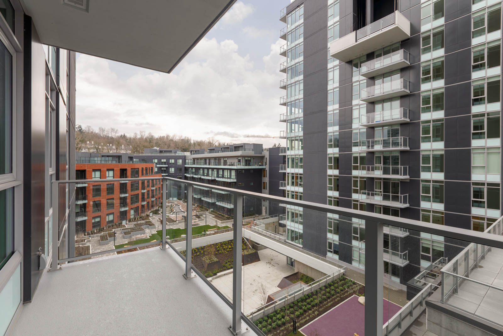 balcony of empty condo managed by birds nest properties at avalon 2 at 8570 rivergrass drive in river district vancouver