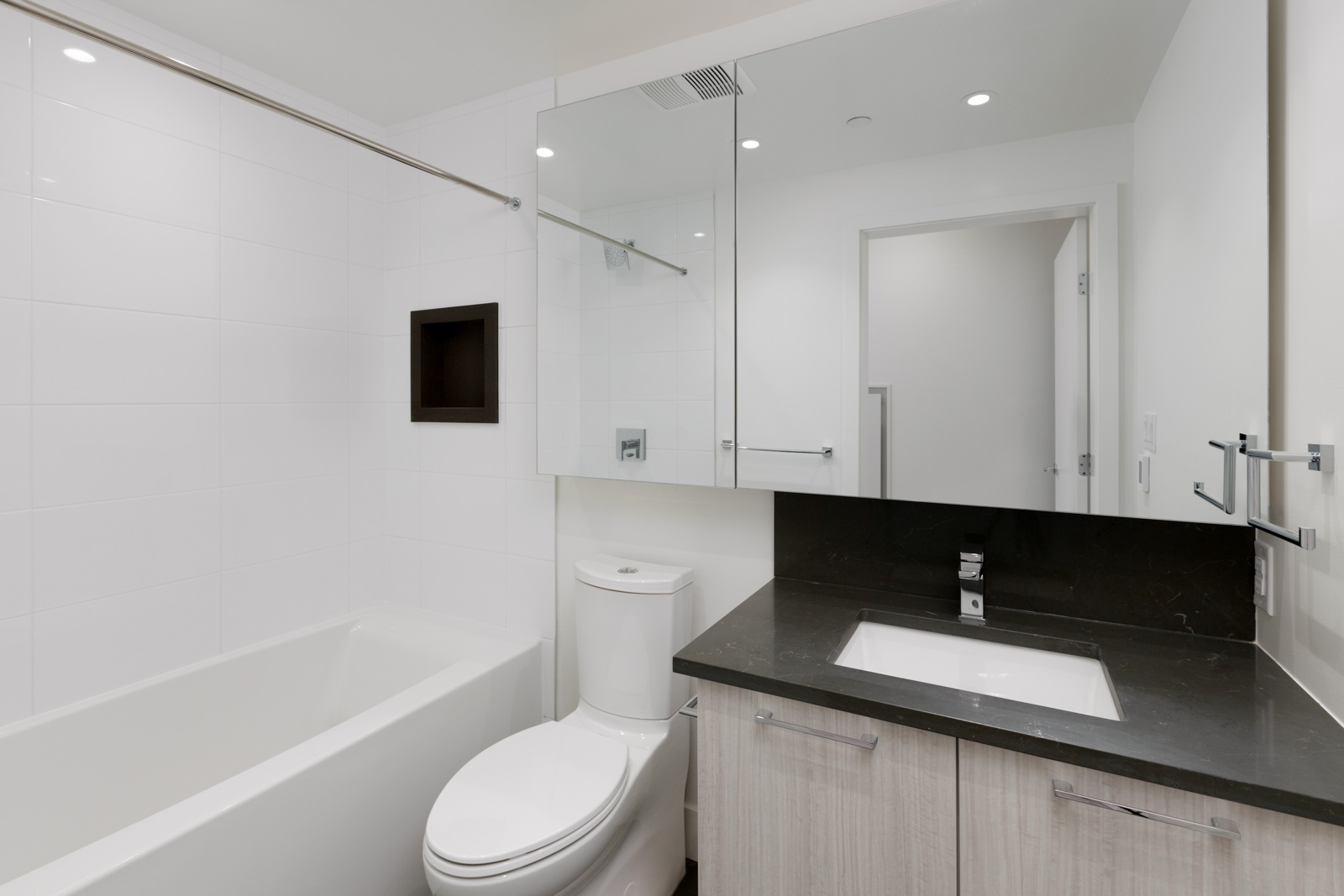 bathroom of empty condo managed by birds nest properties at avalon 2 at 8570 rivergrass drive in river district vancouver