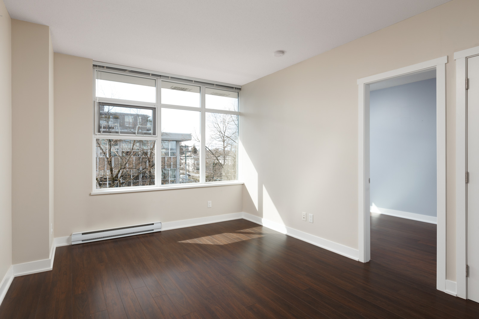 open living room with modern design and hardwood floors with bright lighting in a rental condo in vancouver at kits360 on west 7th managed by birds nest properties