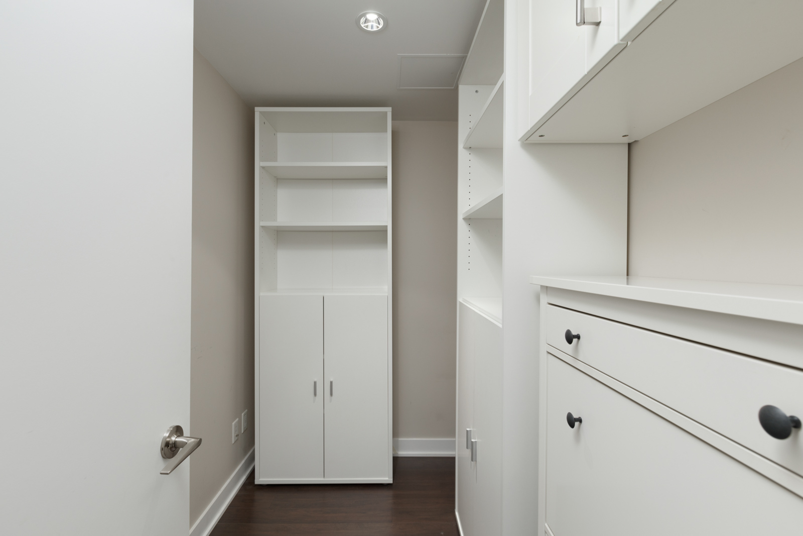 spacious in-house storage closet with wooden storage units and hardwood flooring with bright lighting in a rental condo in vancouver at kits360 on west 7th managed by birds nest properties