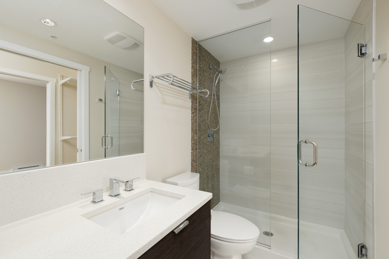 bathroom with closed door and mirror on left in a rental condo in vancouver at kits360 on West 7th Avenue managed by birds nest properties