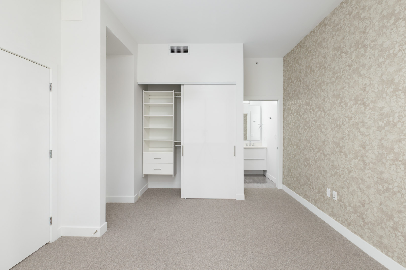 Spacious bedroom with a large closet with organizers built-in and access to the bathroom in a rental townhouse in West Vancouver listed by Birds Nest Properties in Vancouver