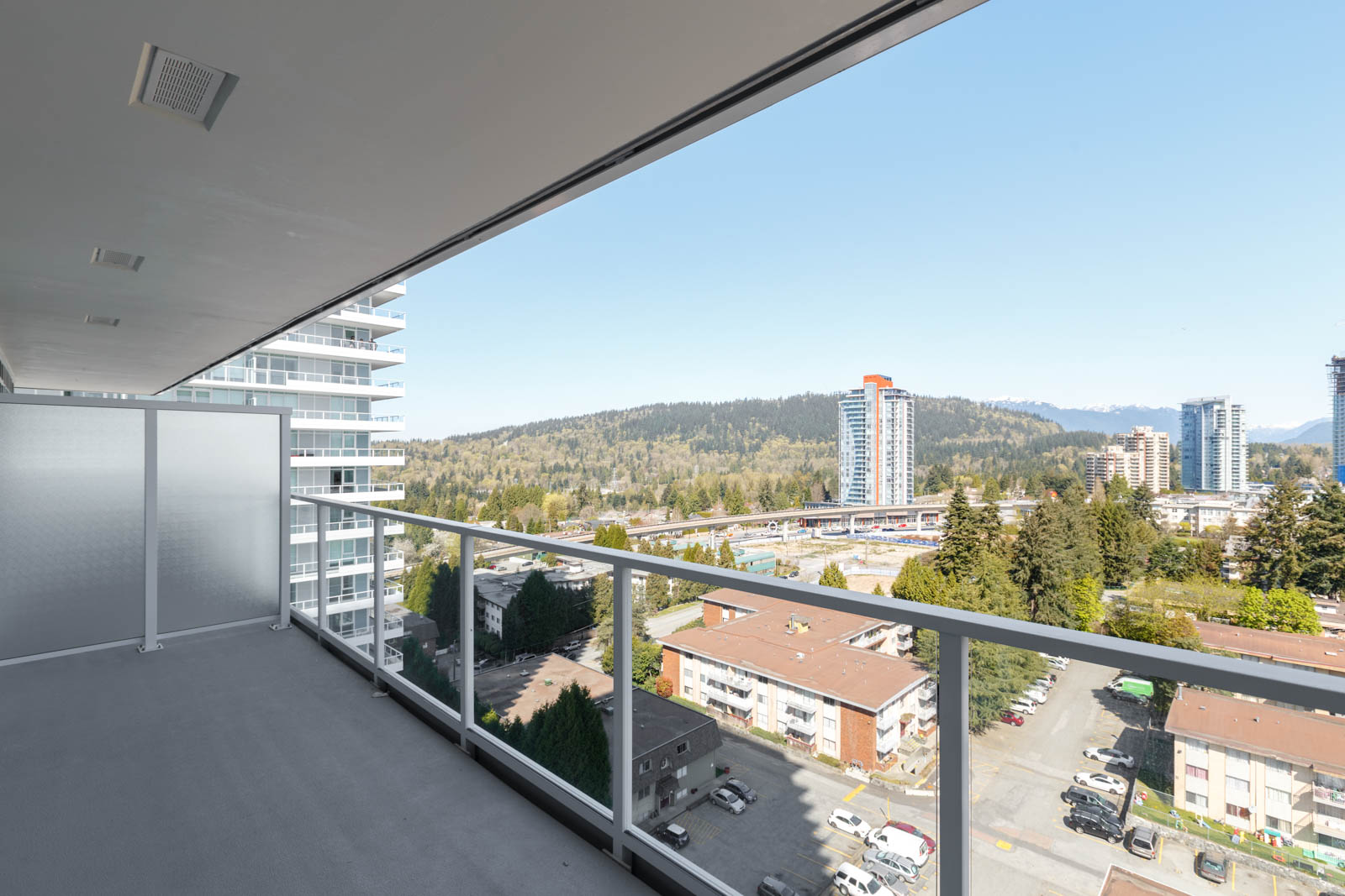 View overlooking the Coquitlam neighbourhood from the balcony in the condo located on Whiting Way and Foster Avenue in a new condo in Coquitlam managed by Birds Nest Properties in Vancouver