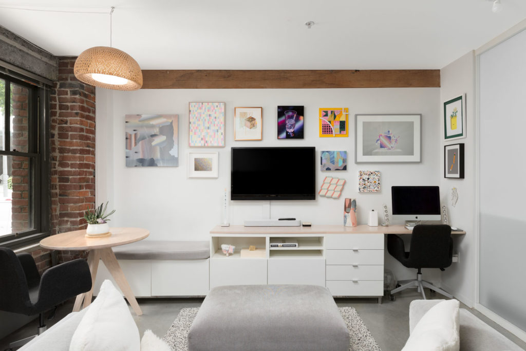 entertainment space in the living area with a workstation on the far right in a rental condo provided by Birds Nest Properties in Vancouver