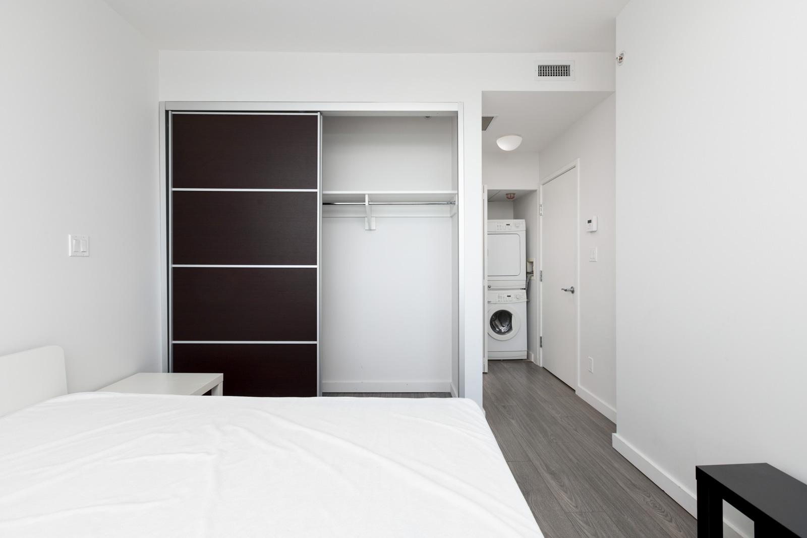Storage closet in open bedroom in a rental condo in Richmond offered by Birds Nest Properties