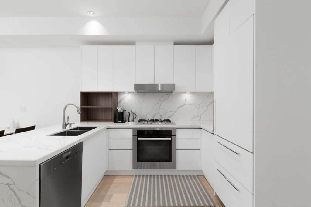 kitchen with appliances of rental condo near commercial drive in east vancouver