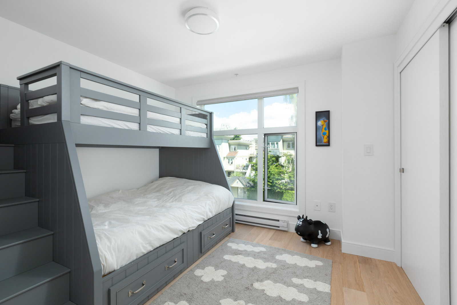 bedroom with bunk bed of rental condo near commercial drive in east vancouver