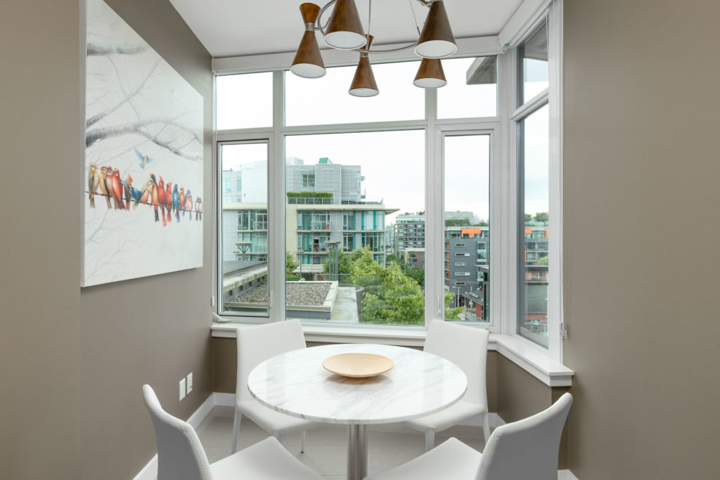 den with white walls and hardwood floors and floor to ceiling windows in rental condo in Vancouver
