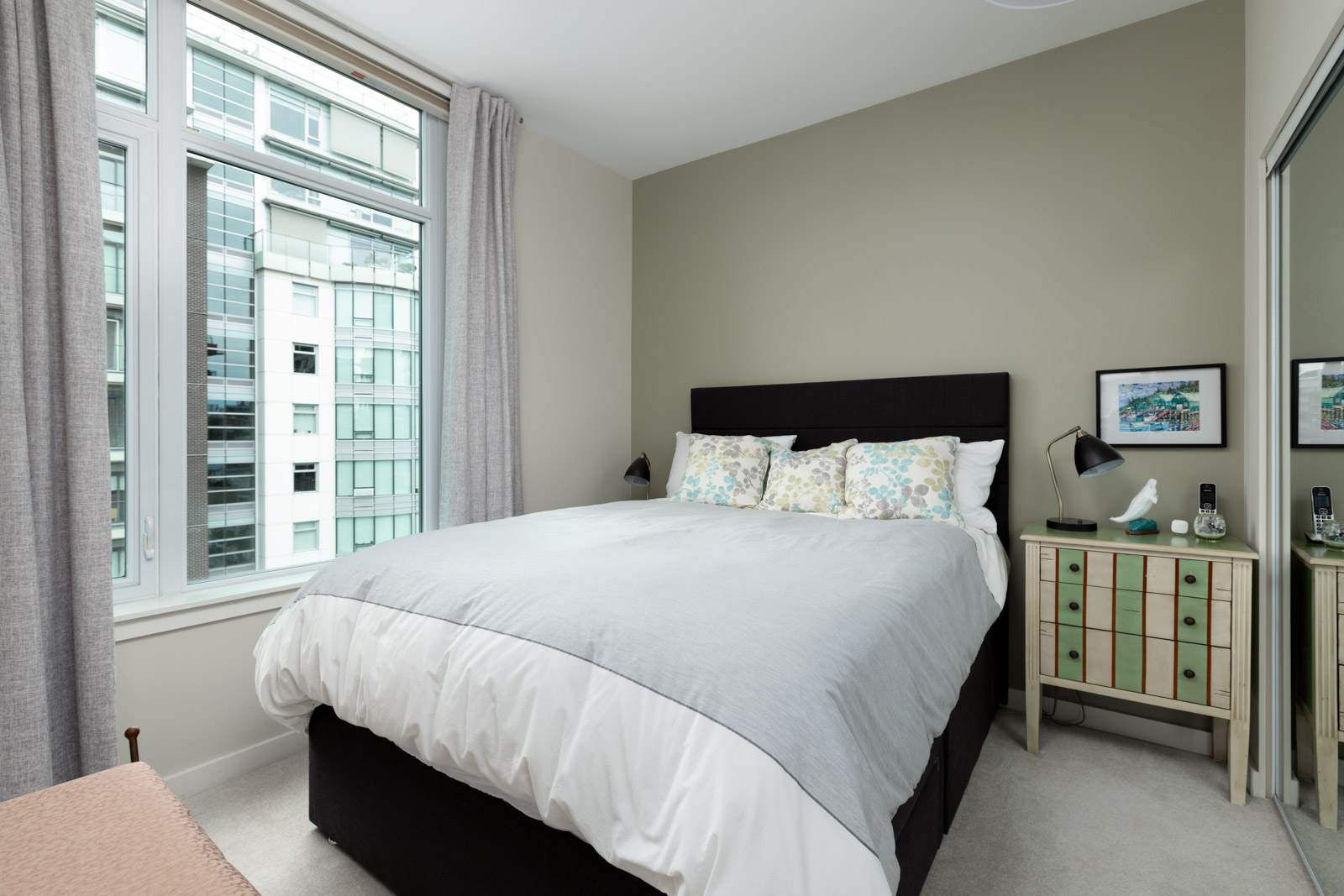 bedroom with white walls and hardwood floors in rental condo in the False Creek neighbourhood of Vancouver
