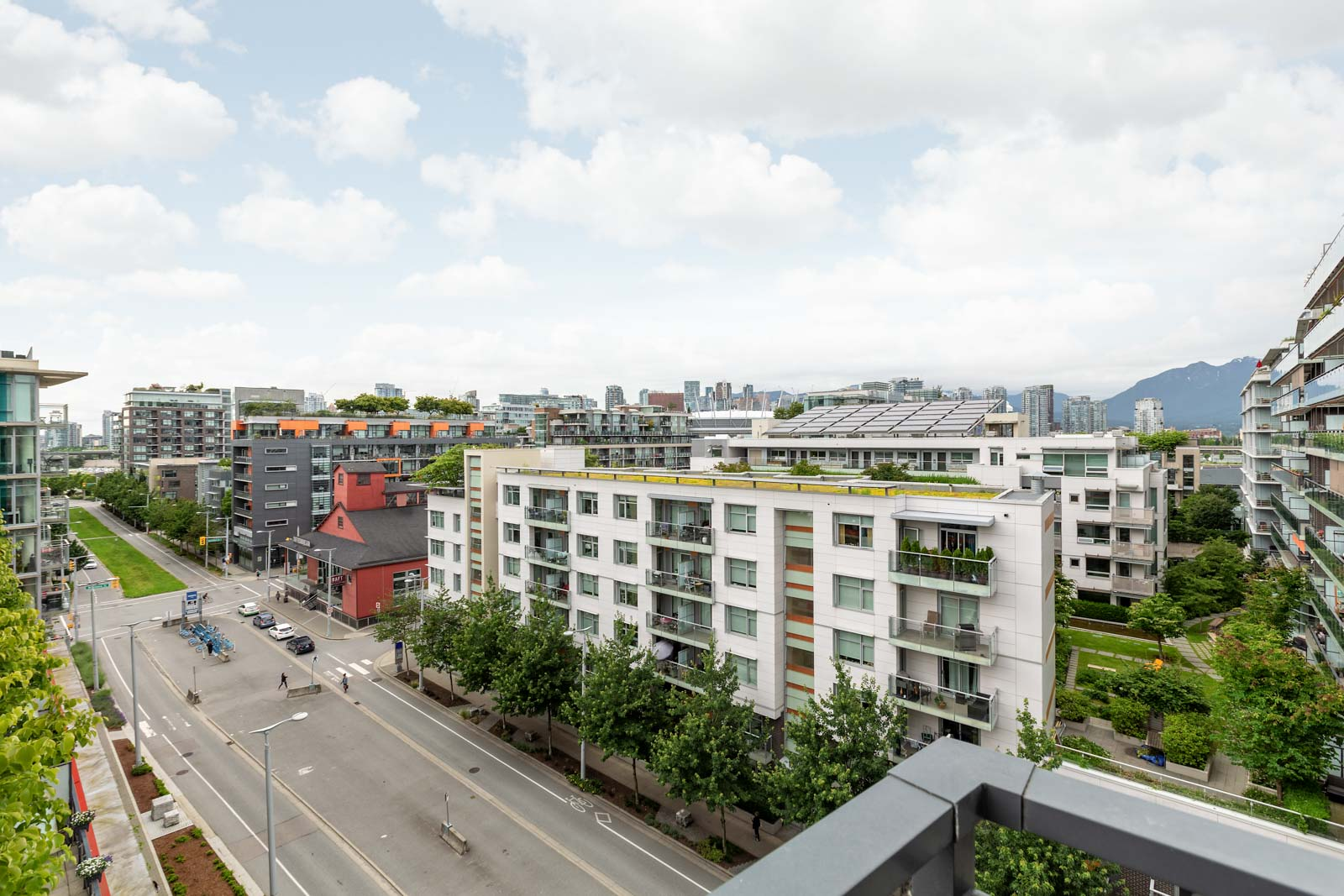 balcony with view of clear sunny skies in rental condo in the False Creek neighbourhood of Vancouver