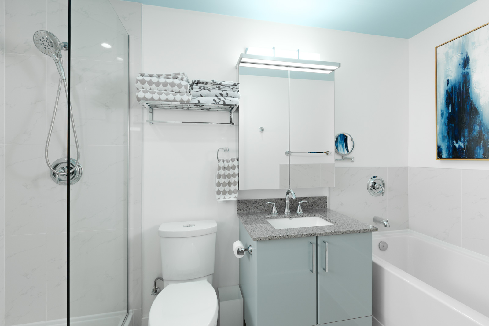 bathroom with showers on the left, bath tub on the right