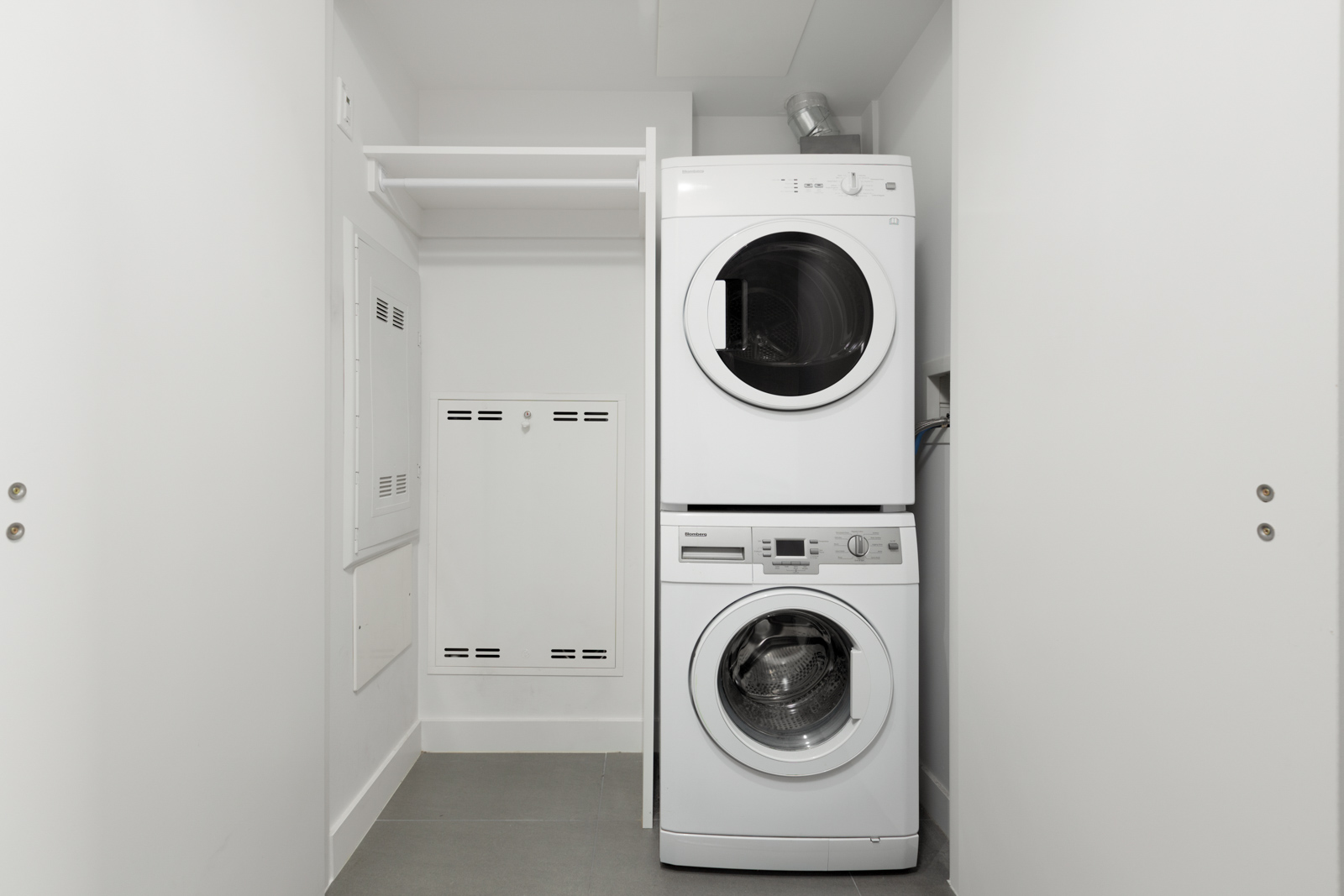 Storage closet with in-suite laundry in a rental condo in Vancouver offered by Birds Nest Properties.