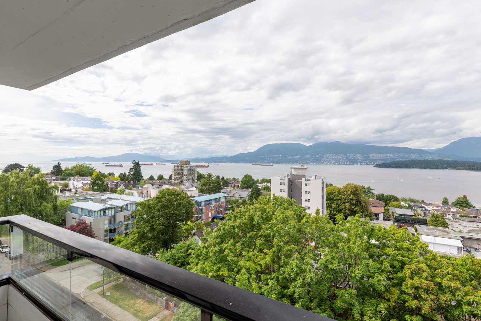 view of english bay from balcony of kitsilano rental condo managed by birds nest properties
