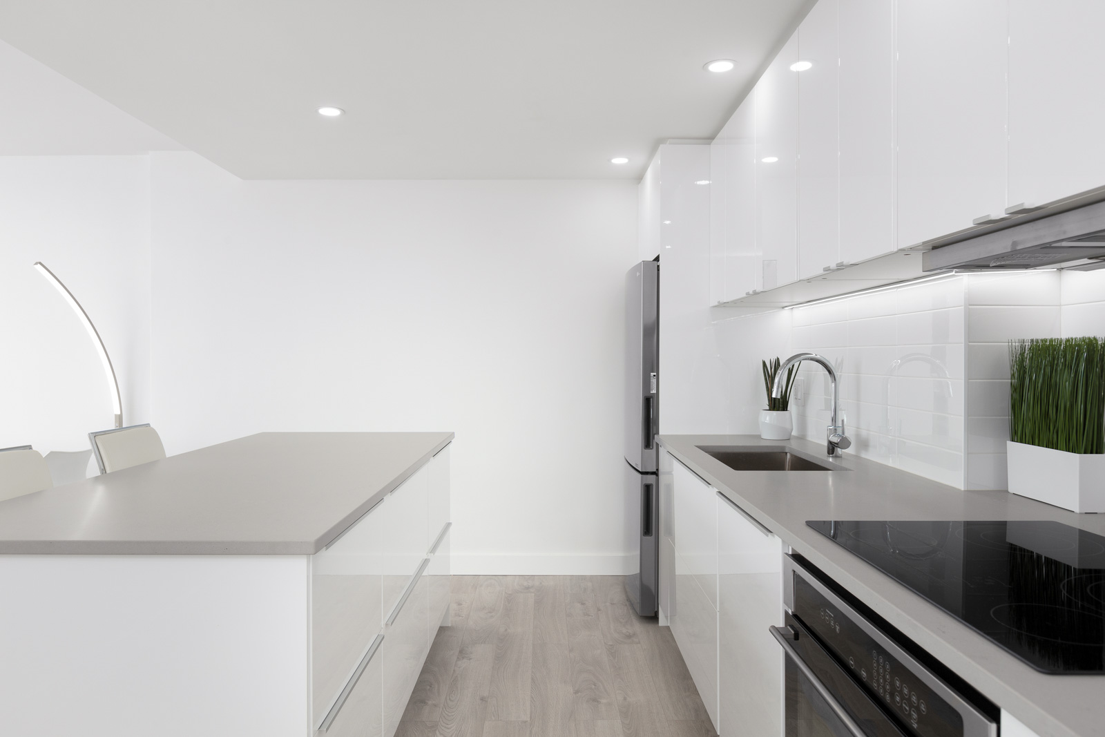 kitchen of rental property with island on left and stove and oven on right in rental apartment in kitsilano