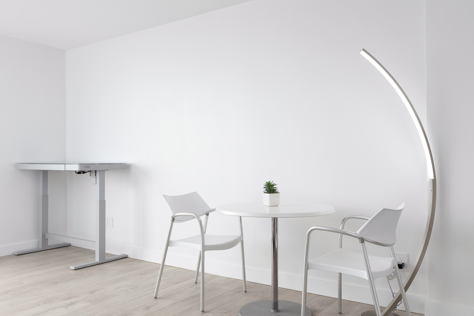 chairs and table against white wall of rental apartment in kitsilano neighbourhood of vancouver