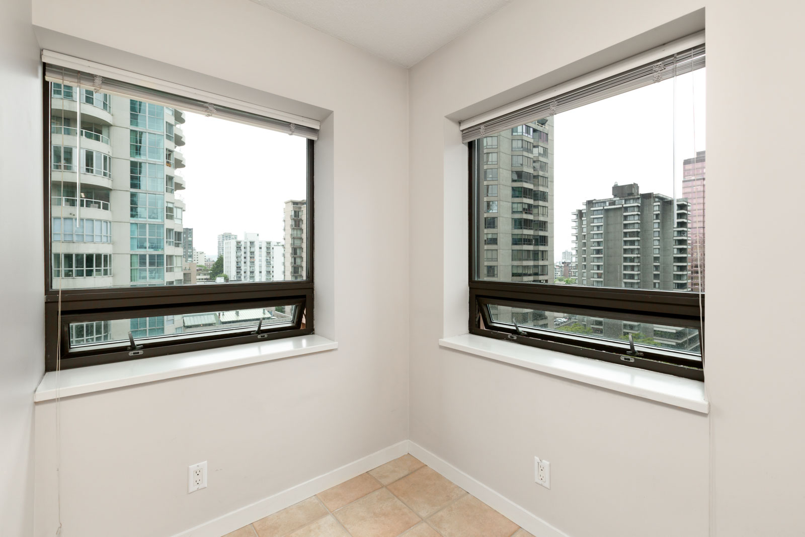 bedroom with white walls and window in rental condo in the Downtown neighbourhood of Vancouver