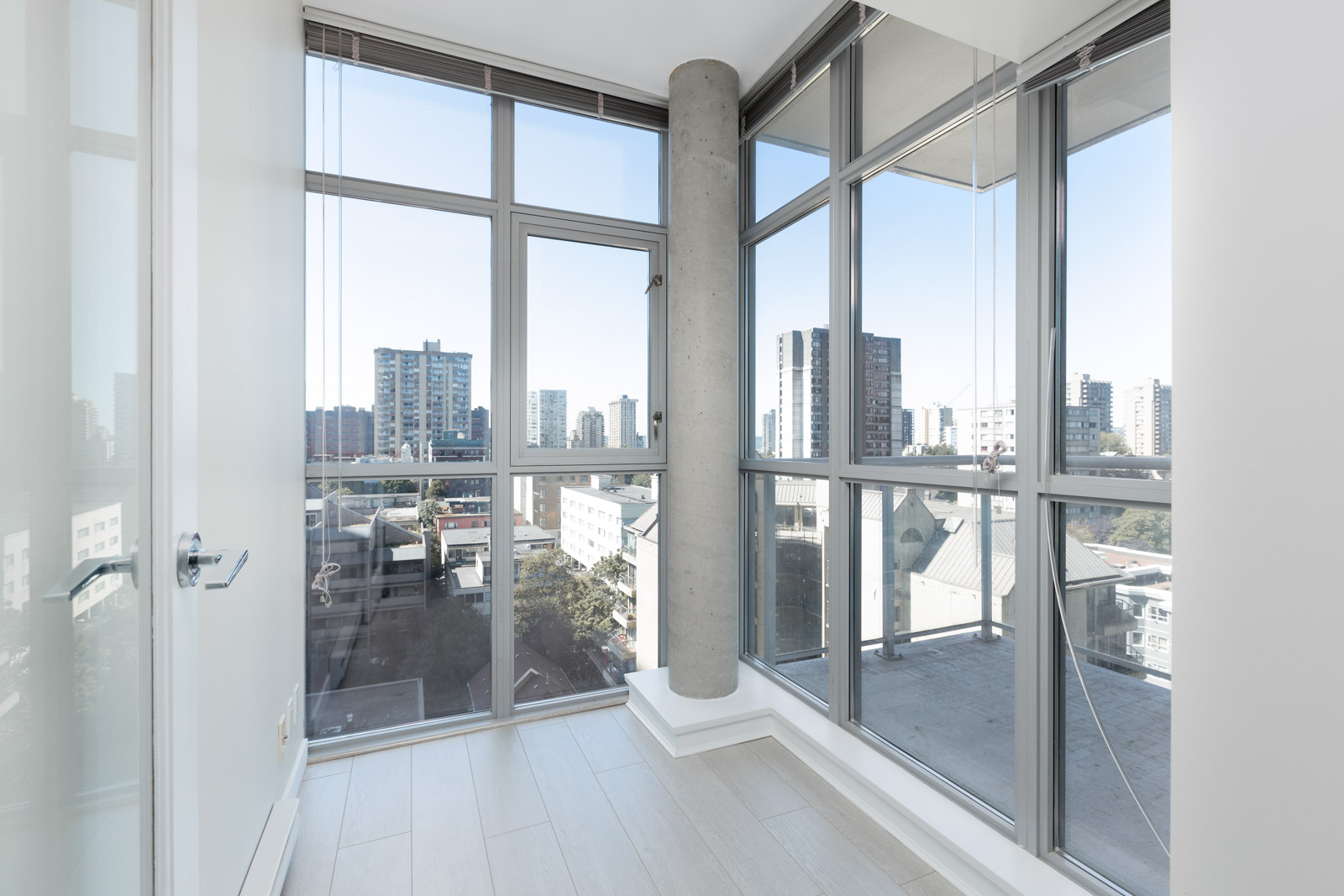 bright room with large floor to ceiling windows in rental property in the sterling condo building in downtown vancouver