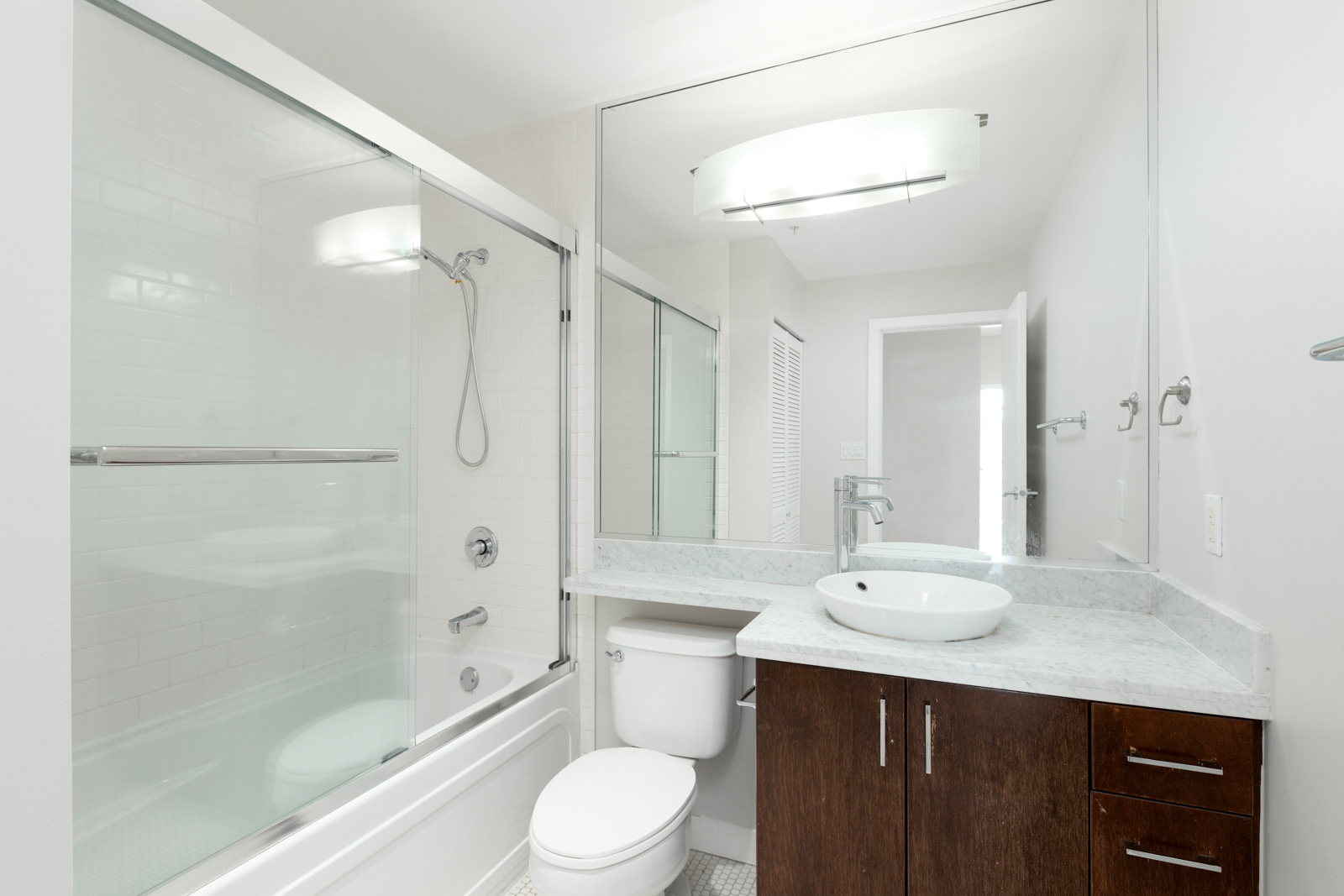 bathroom with bathtub on left and mirror and vanity on rightin rental property at the sterling building in the west end of downtown vancouver