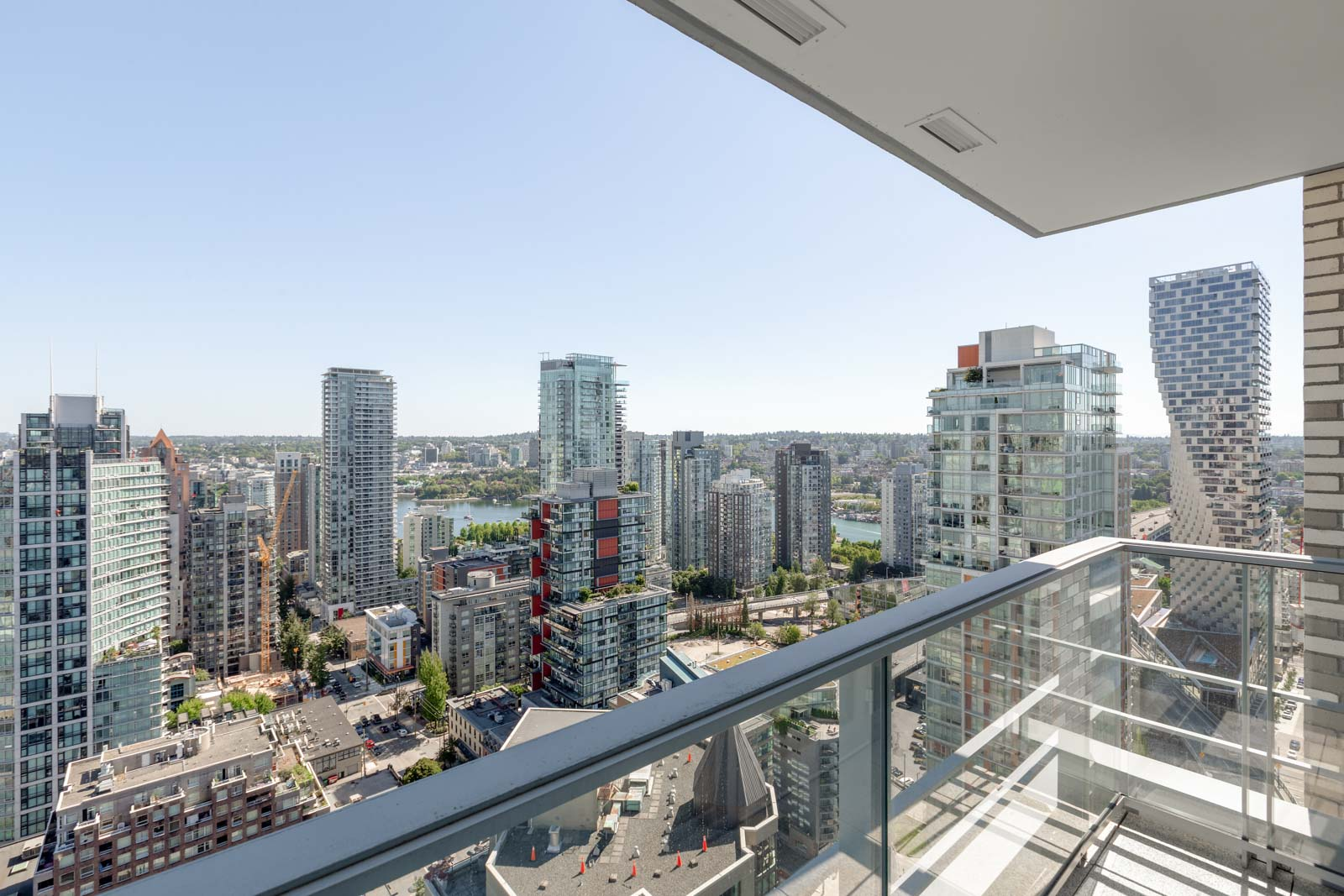 balcony with view of clear skies in rental condo in the Yaletown neighbourhood of Vancouver