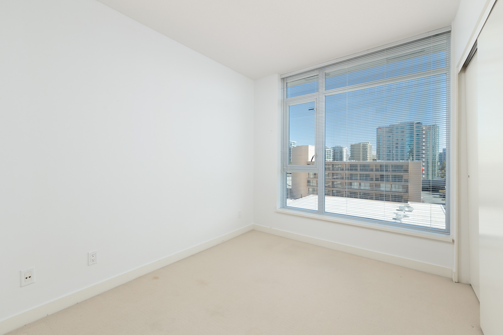 bedroom with white walls and window in rental condo in the Garden City neighbourhood of Richmond