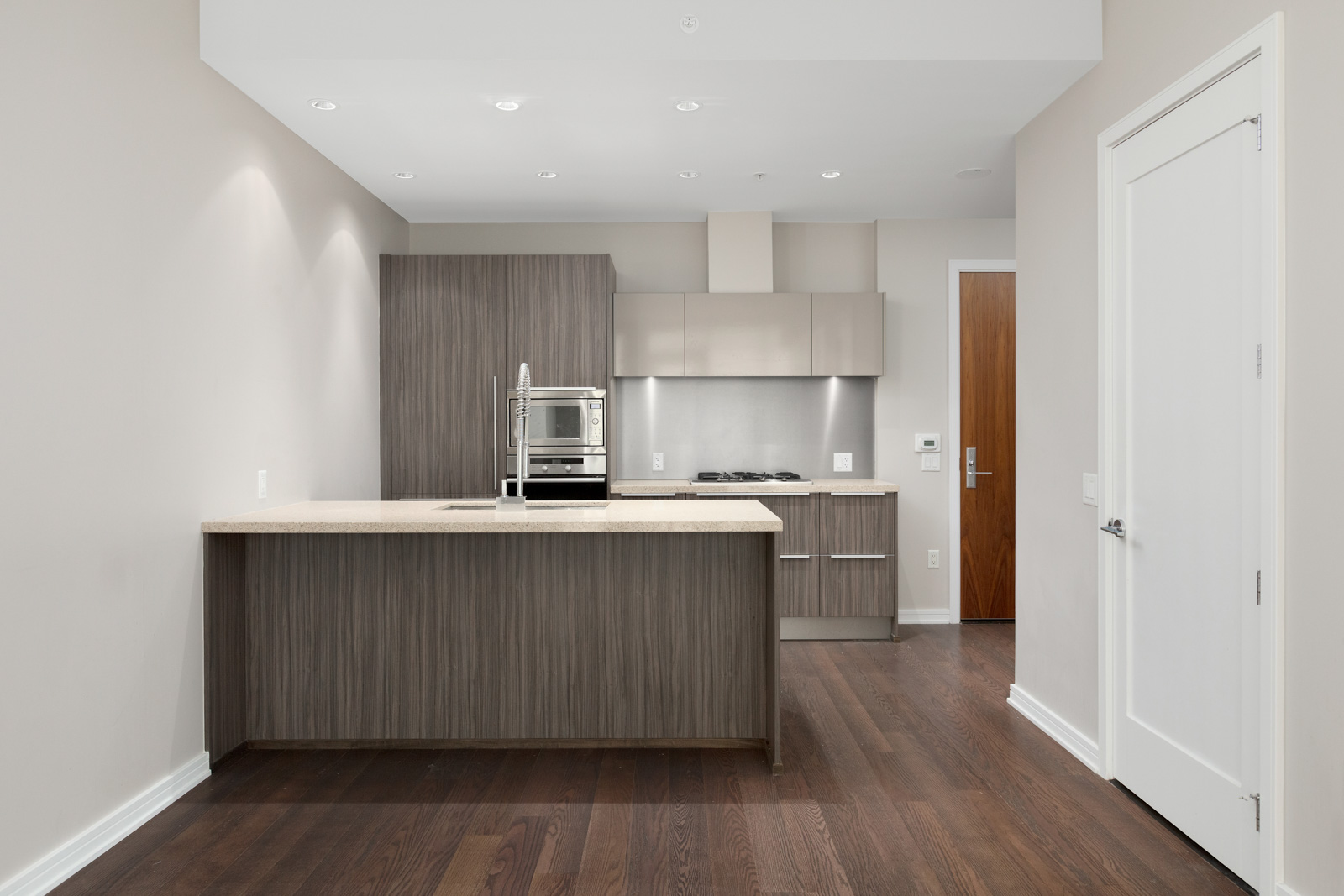 kitchen view of 1633 ontario street. you can find the door the right, with the kitchen in the middle.