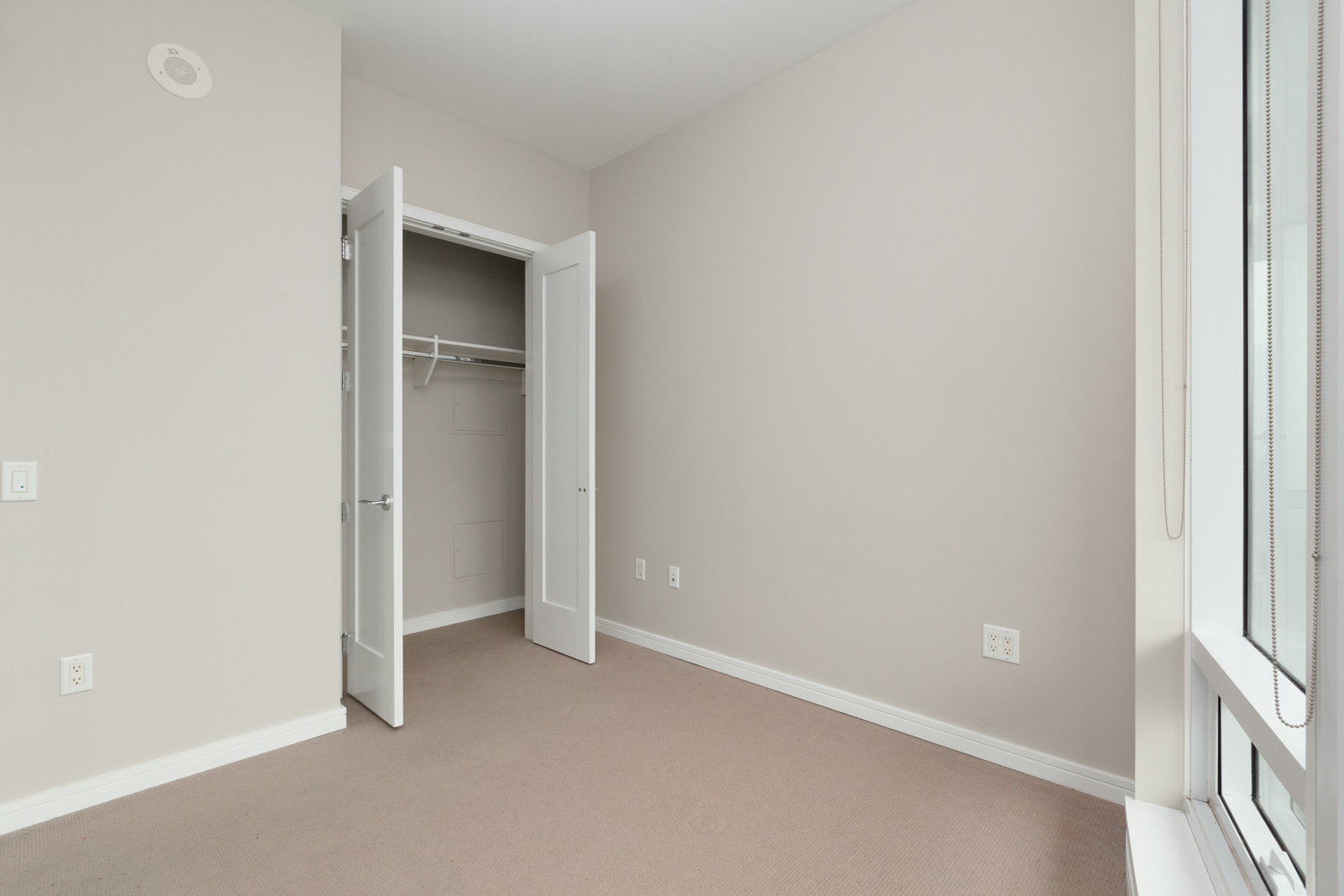 bedroom view and a shot of the closet room at 1633 ontario street, vancouver, condo