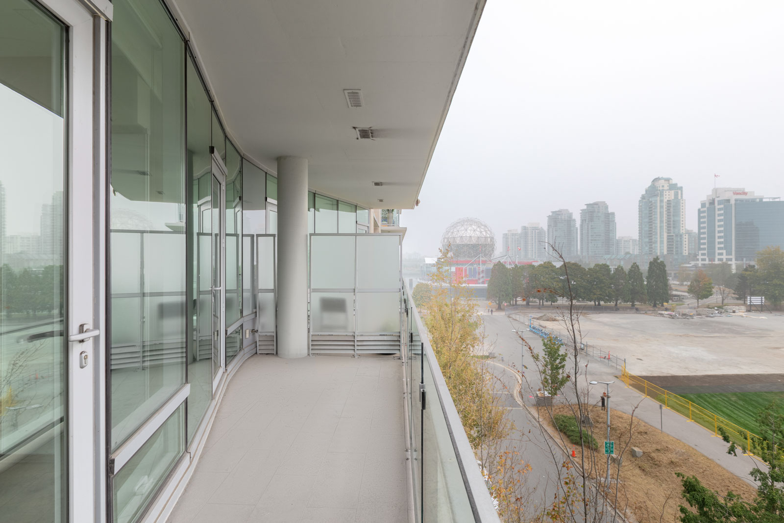 balcony view of from the unit, view of seawall and city life at olympic village on ontario street.